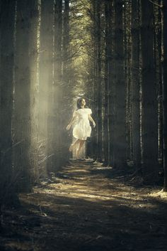 Young girl floating in the woods -Photography Dark Lights