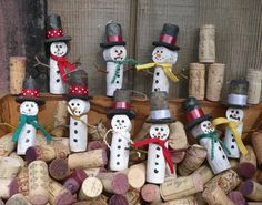 I start with used wine bottle corks then add a little of this and that to create these fun little 4 tall snow guys. I make them to hang so theyre naturals for your Christmas tree or anywhere youd like a spot of brightness.  They are priced per each so order one or a bunch. No two are quite alike. The ones you get will be slightly different but every bit as neat.    shop me: http://www.etsy.com/shop/ShadeTreeClassics