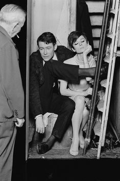 Peter O'Toole and Audrey Hepburn in the closet while director William Wyler looks on.