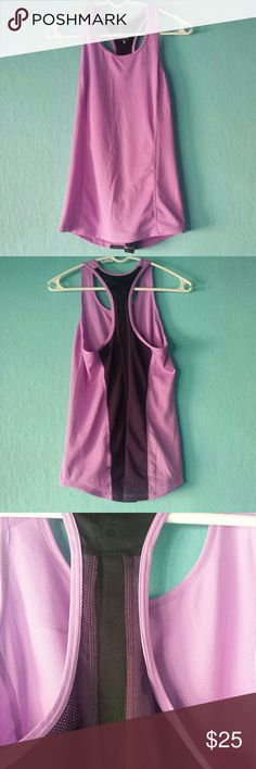 Nike Dri Fit Racerback Work Out Tank Top This Nike Dri Fit Racerback tank is in excellent condition!  Size small, color is purple with black mesh going straight down the back for enhanced air flow. Very comfortable work out tank!   No rips, stains, or pilling! Excellent condition. Nike Tops Tank Tops