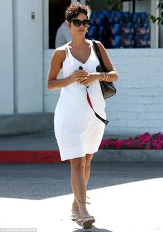 Spring in her step: Mother-of-five Nicole Murphy was showing some skin as she headed out to pick up some groceries in Beverly Hills on Sunday
