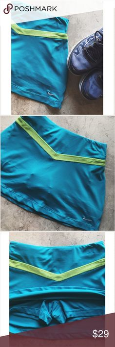 Nike dri-fit skirt Sporty and feminine! Built in shorts. Never been worn. Perfect condition no snags. Perfect for tennis players Nike Skirts