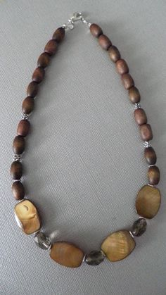 Natural Amber Shell with Wooden Beads Necklace from Etsy