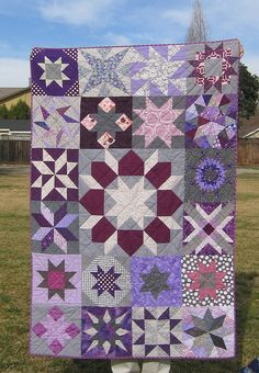 October 2011 Grace Purple & Grey Star Quilt.  I would remove the large center one and just put more of hte small square stars