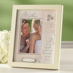 http://www.exclusivelyweddings.com/Weddings/Wedding-Accessories/Bridal-Accessories/Wedding-Memories-Frames-Albums/Mothers-Shadow-Box-Frame?adpos=1o9&creative=57265710565&device=m&matchtype=&network=g&gclid=Cj0KEQjwjIy5BRClh8m_9Zu64d8BEiQAtZsQf1P-Vh1RaNrd0OktVjKMTJEu3kO6UCPnMswz-QvfbUwaAsu48P8HAQ