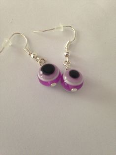 A personal favorite from my Etsy shop https://www.etsy.com/listing/244218396/purple-earrings-purple-black-and-white