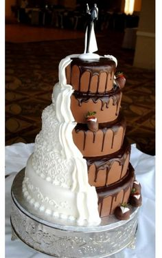 Bride and groom wedding cake-This is so cool!! Although Joseph would probably want half of it to be a cheesecake. ;)