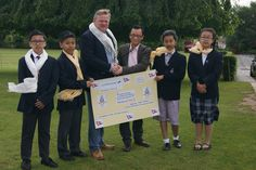 Mr Gumbo Tharang collecting the cheque from Bromsgrove Preparatory School for the Nepal Earthquake Appeal.