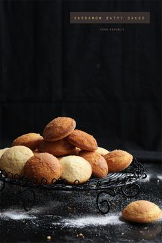 Cardamom Patty Cakes - Cook Republic Lighting, dark mood, rack, soft looking food, sprinkled sugar and left placement
