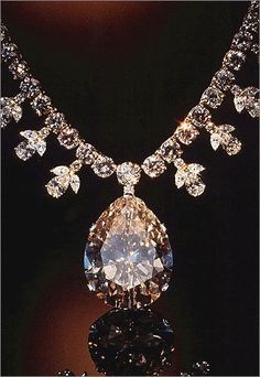 Victoria-Transvaal Diamond The dazzling pendant of this diamond and gold necklace is the 68-carat, champage-colored Victoria-Transvaal diamond, which was discovered in South Africa in 1961.