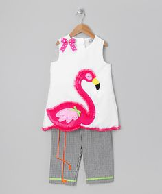 Any little sweetie will look flamingo-fantastic in this stylish and surprising outfit. The ruffle- and sequin-embellished top features a fun flamingo appliqué with legs that go all the way down the matching seersucker capri pants. Includes top and capri pants55% cotton / 45% polyester exclusive of decorationHand wash; ha...