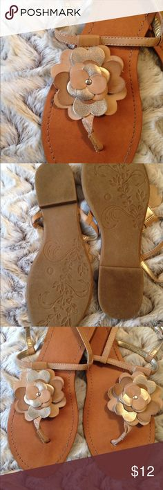 SO T-strap Gold Tan Flower Sandals Adorable sandals from Kohls. Great condition apart from scuff on toe of one sandal (as shown in pic). Wore a couple times. Size 8 SO Shoes Sandals