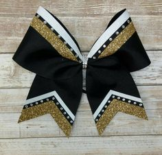 Hey, I found this really awesome Etsy listing at https://www.etsy.com/listing/505600263/black-and-gold-cheer-bow-black-and-gold