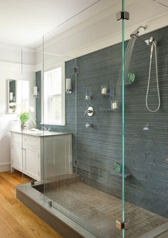gorgeous master bath - love the forest green tile; shower shelves; clear glass doors (these are the exact doors that I have); molding; window over sink w/mirror on adjacent wall; honey wood floors