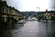 Another view of the flood in Harrow Monorway, looking towards Knee Hill where the buses can be seen. On the right the Abbey Arms and a police call box. 14th September 1968.