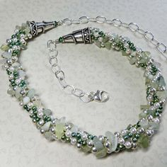 Necklace of Freshwater pearls, amazonite chips, silver beads in Kumihimo style.