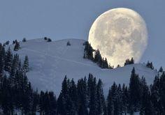 Full moon seen behind Mt. Untervaz (GR), Switzerland