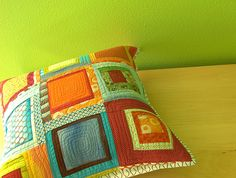 Brightly-colored quilted pillow, why are you not mine?