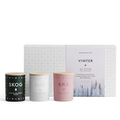 SKOG, SNÖ & BÆR. Crystal freshness, silent panoramas of evergreen and white, the irresistible allure of hibernation. A triptych of home fragrances celebrating the Scandinavian priority of creating intimacy, fellowship and cosiness in the smallest everyday moments.Hand-poured into painted glass votives from a blend of perfume and vegetable wax with a 100% cotton wick and protected by a special gift box. Each candle will burn for 16 hours and each votive is designed to be re-usable for…