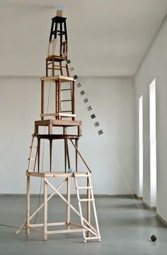 Line / Implied / JOÃO FERRO MARTINS . . . our eye is drawn vertically through the towering boxes, and then taken down diagonally via the string.