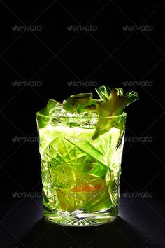 Green cocktail like mojito on dark background ...  alcohol, alcoholic, bar, beverage, black, bright, carambola, citrus, cocktail, cold, cool, dark, drink, food, fresh, freshness, frozen, fruit, garnish, glass, green, ice, ingredient, juice, juicy, kiwi, leaf, lemon, lime, liquid, liquor, mint, mix, mixed, mojito, nightclub, party, peppermint, refreshing, refreshment, rum, slice, sour, sugar, sweet, syrup, thirst, transparent, tropical, vertical
