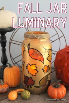 SEPTEMBER Fall Jar Luminary -- turn a mason jar or old pickle jar into a great fall jar luminary for your home decor. Some glass paints and masking is all it takes! Mason Jar Projects, Mason Jar Crafts, Mason Jar Diy, Bottle Crafts, Autumn Crafts, Thanksgiving Crafts, Holiday Crafts, Harvest Crafts, Diy Autumn
