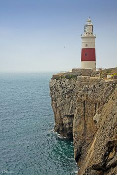 Europa Point Lighthouse. Europa Point is a strategic location at the southern tip of the peninsula of Gibraltar. Prior to its opening in 1841, sailors navigating the Strait of Gibraltar near Europa Point were dependent upon the light emitted by the Shrine of Our Lady of Europe. The sailors showed their gratitude and encouraged the continued burning of the lights by leaving supplies of oil at the shrine. (V)