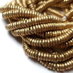 African Beads - Rustic Antique Brass Metal Heishi Spacers (50 beads) African Brass Spacers. $4.25, via Etsy.