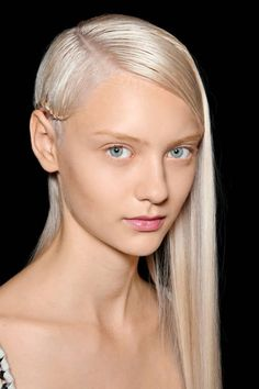 2013 SLEEK AND STRAIGHT: ADD ON A severe part and a braid add an unexpected edge. Tie the braid behind the ear, or braid the entire length of the section, looping across the hair and securing behind the opposite ear with a bobby pin, as seen at Herve Leger by Max Azria.