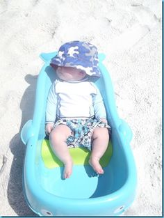 Tips for a Baby at the Beach. This lady is genius! Bringing a baby tub to fill with ocean water is so smart! @Jeanne Bright Lynch Great Idea to Keep Kaylan cool this summer, put a beach umbrella over her and she would be one happy girl :)