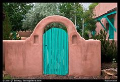 Blue door and adobe yard wall. Taos, New Mexico, USA (color)  For our side gate