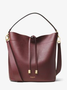 With a spacious silhouette, our large Miranda shoulder bag is a thing of beauty. In true Michael Kors fashion, we accented the supple French calfskin with polished hardware and protective metal feet. Whether you carry it by the top handle or opt for the shoulder strap, it's an instant outfit elevator.