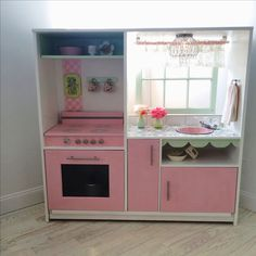 Diy play kitchen made from old entertainment center.