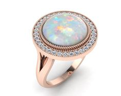 9ct Rose gold opal halo split shank and cz by IsaBellaJewellery