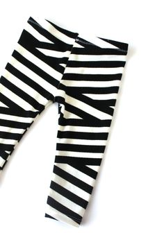 These leggings add a fun play on the classic, modern black and white stripes.  Pair these with any outfit, any season. They are unisex so any little can rock them!Since every item is made to order, please allow up to 3 weeks for production before shipping.