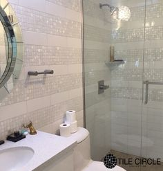 Amazing bathroom tile installation featuring mother of pearl tiles by Tile Circle. Available at TileCircle.com