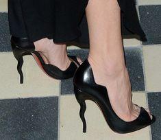 Kate Hudson wearing Christian Louboutin wavy open-poe pumps