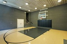 A custom-built home in Glencoe, Ill., features a modern basketball court, complete with adjustable backboard and storage closet. Home Basketball Court, Basketball Court Flooring, Indoor Basketball, Basketball Stuff, Basketball Hoop, Hot Pink Bedrooms, Huge Houses, Luxury Portfolio, Home Theater Design