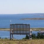 A bench sits on the Highest point on Cuttyhunk Island - Lindsay & Nate have wedding pictures sitting on that bench!