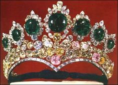 Tiara designed by Harry Winston, the New York jeweller, for the occasion of the marriage of Empress Farah and Reza Shah Pahlevi in 1958. The lower band containing diamonds which is shaped like a heart, is built of platinum. There are two rows of yellow, pink and clear diamonds on top of it. There are seven large emeralds framed by diamonds on very top of the tiara.