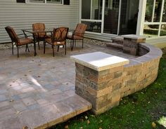 Norland Landscape paver patio. Love the integrated paver wall and column