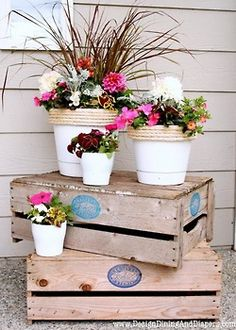 Love this for front porch--crates with dollar store flower pots. would also lood great with wirl crates Front Porch Garden, Diy Porch, Porch Ideas, Diy Patio, Outdoor Projects, Outdoor Decor, Outdoor Spaces, Wood Projects, Summer Porch