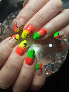 Neon pigments with freehand nail art