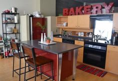 """Letters spelling """"bakery"""" above the cabinets. Other ideas: """"kitchen,"""" """"food,"""" """"gourmet,"""" etc."""