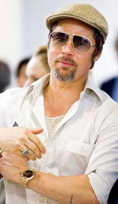 Brad Pitt wearing a yellow gold Rolex Day-Date II