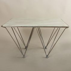 Found it at AllModern - Pei Coffee Table http://www.allmodern.com/deals-and-design-ideas/p/Design-Duo%3A-Marble-%26-Metal-Pei-Coffee-Table~VSR1403~E22434.html?refid=SBP.rBAZEVW1Uc0Rm3PRoD_nAtWuSdP9w0nvupfLZHGF-Iw