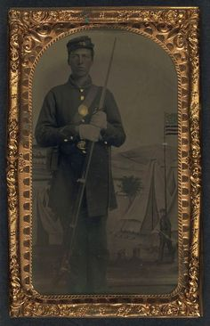 (c. 1861-1865) Soldier in Union frock coat, forage cap, and gloves with bayoneted musket