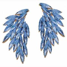 One Left Blue Luxe Wing Crystal Earrings Absolutely stunning T&J Czech Crystal Earrings. I am absolutely OBSESSED with these! Light weight and stand out beautifully in my long dark hair. Kept a pair for myself 😊 18k gold plated. Never worn, in packaging. T&J Designs Jewelry Earrings