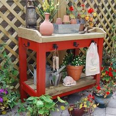 Porch bench as gardening table...Add pots, watering can, and tools to new table on back porch
