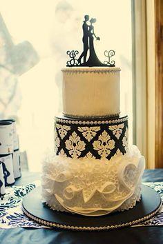 ...lovely black & white wedding cake with charming cake topper